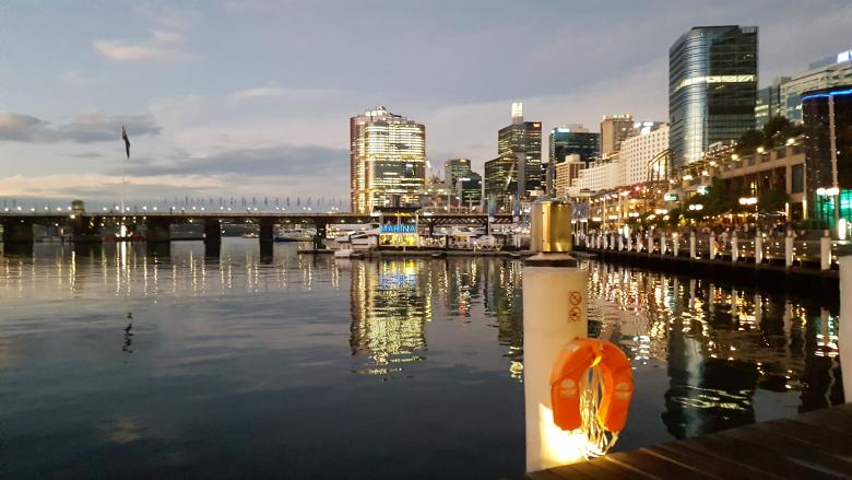 An overview of Sydney's Darling Harbour at dusk