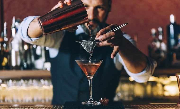 Image of a bartender making a cocktail