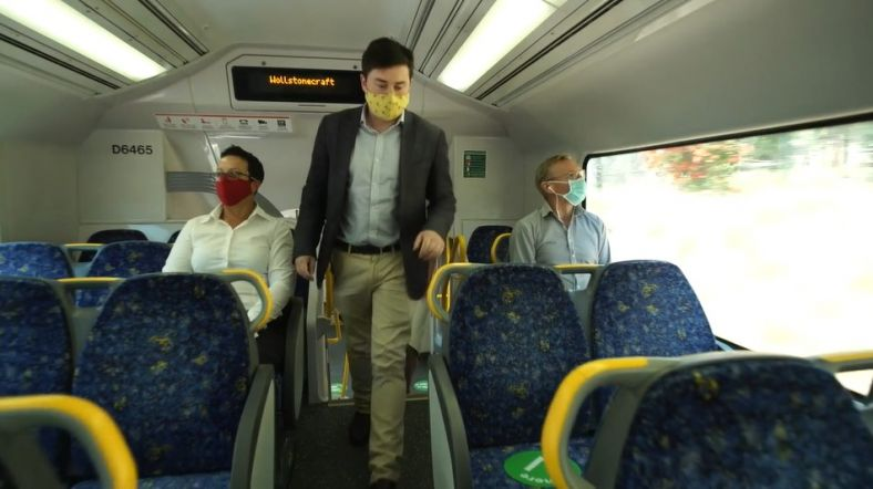 Commuters wearing a face mask on a NSW train