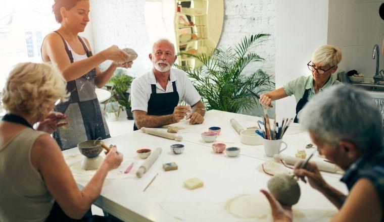 Seniors participating in a ceramics class